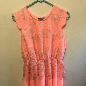 Bright coral lace dress.